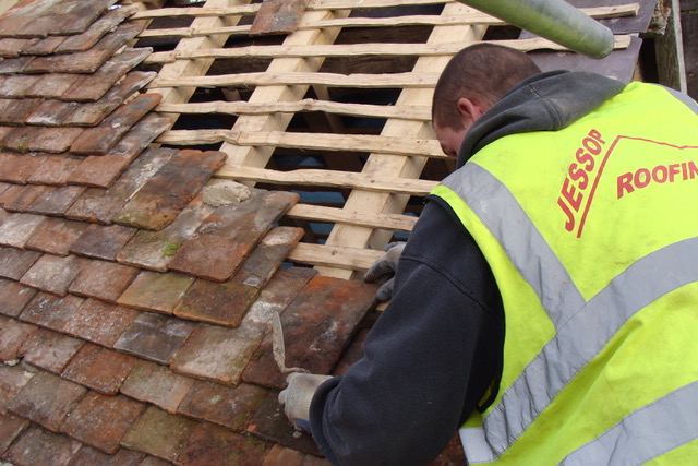 Tiles being laid in a traditional lime mortar mix