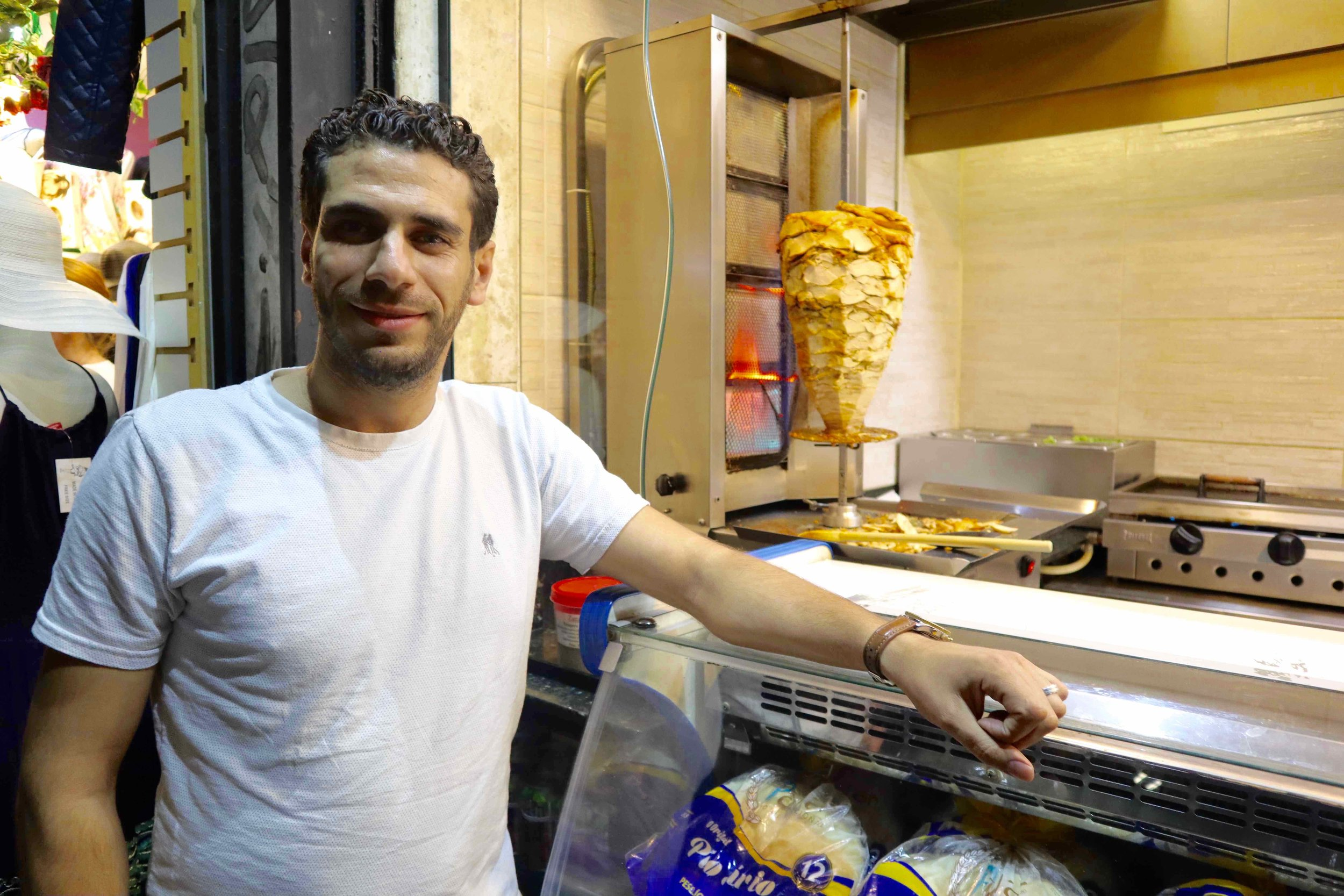 Ahmad came to Brazil through the country's special Syria humanitarian visa program. He's now settled in São Paulo with his family and has a string of successful restaurants, including this popular eatery selling delicious Shawarma and Syrian deserts.