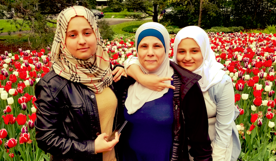 Thikra with her daughters Rowan (right) and Roha (left) at a tulip festival in their new home - Ottawa, Canada.