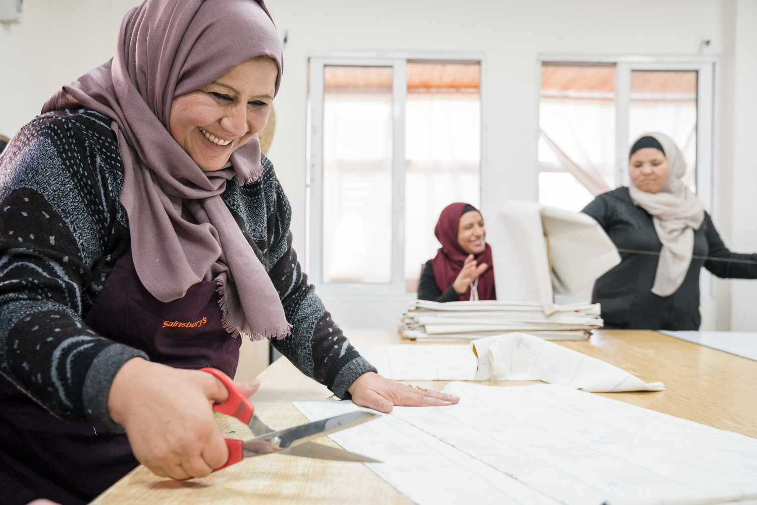 Refugee women working at the Jordan River Foundation/IKEA production facility site – Al Karma Center, Amman, Jordan. Photo: Tent Foundation/Johannes Arlt.