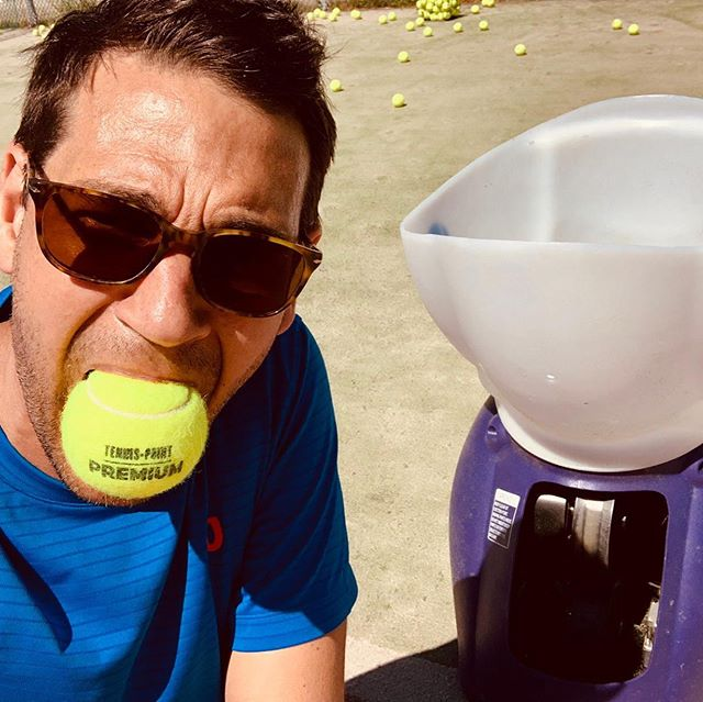 """Philipp feels pure love and appreciation for our new @spinfiresport - ball machine. We tenderly call her """"La Macchina""""."""