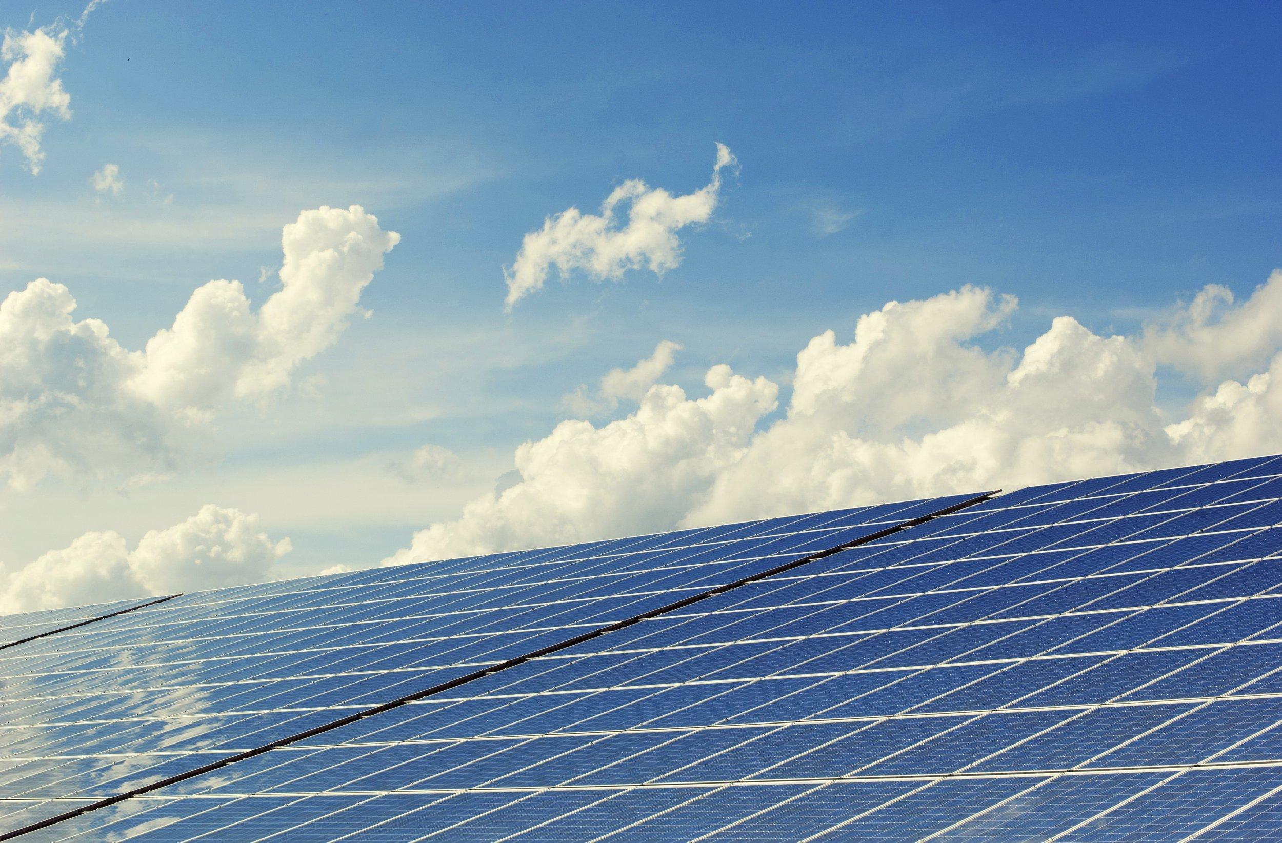 alternative-energy-building-clouds-356036.jpg