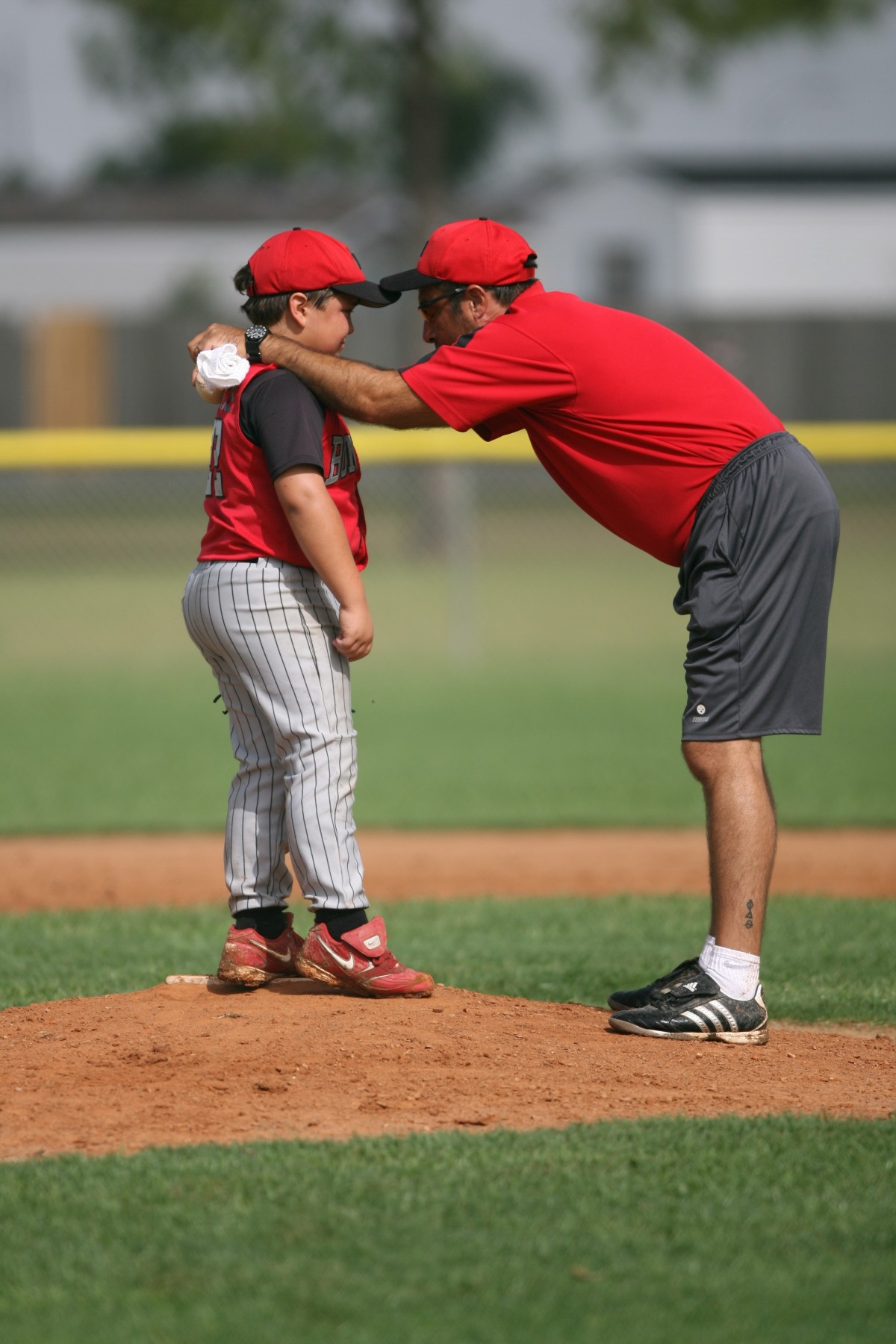 baseball_little_league_pitcher_pitching_mound_coach_conference_children_game-622905 (1).jpg