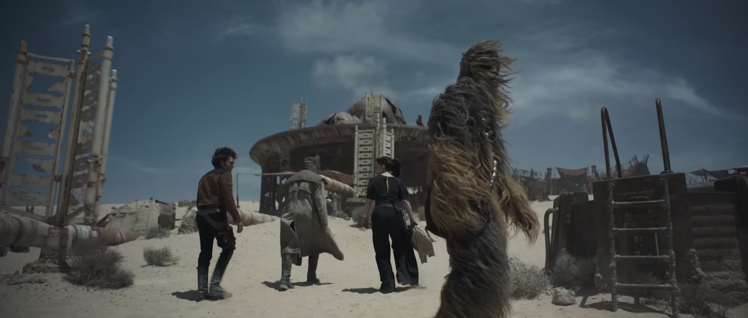 Left to right: Alden Ehrenreich, an unidentified actor, Emilia Clarke, and Joonas Suotamo in  Solo: A Star Wars Story