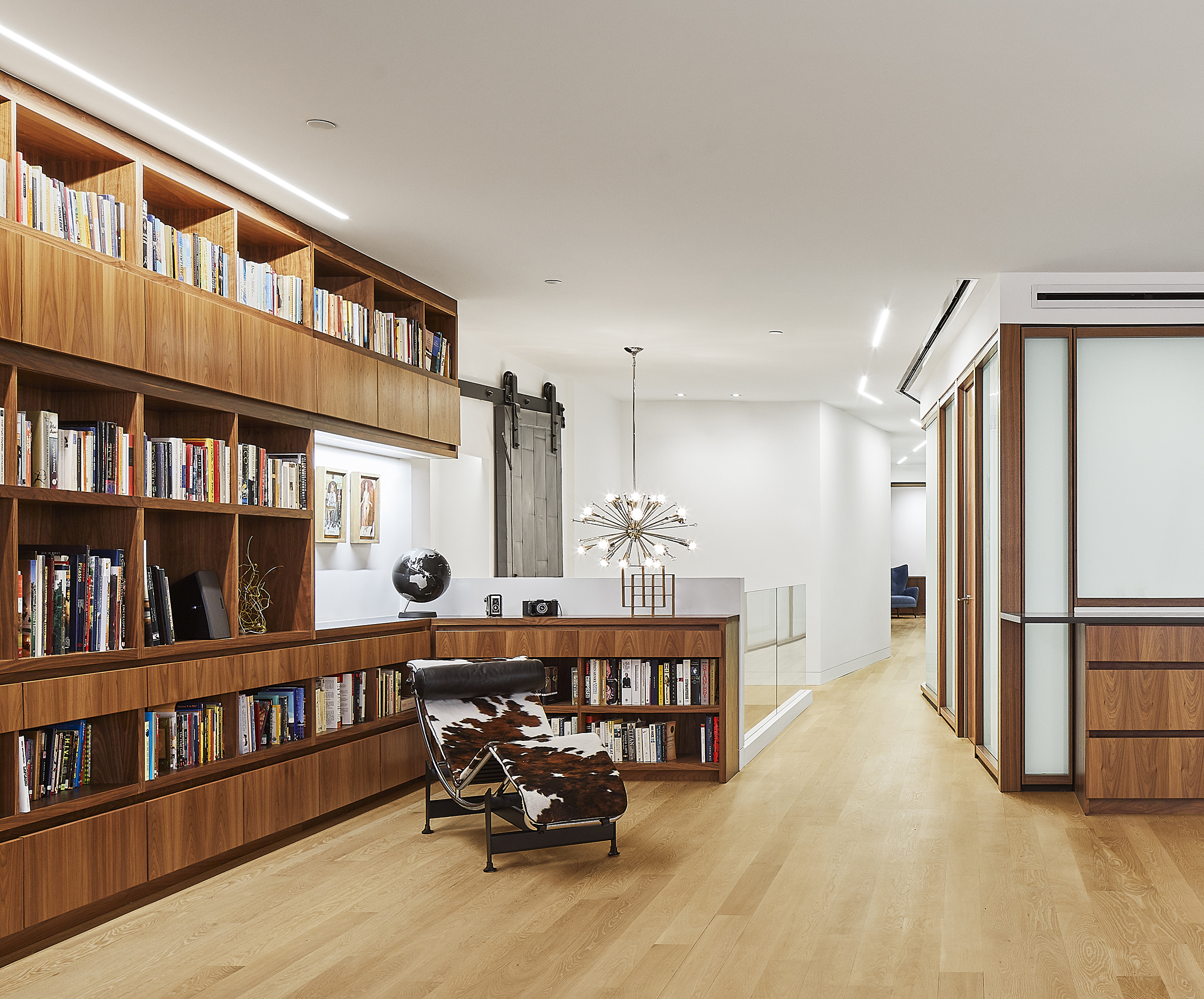 turkel_design_modern_prefab_home_soho_loft_living_room_storage_shelving.jpg