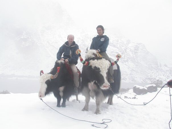 Matt with his yak guide during a trek high up in the Himalayas .