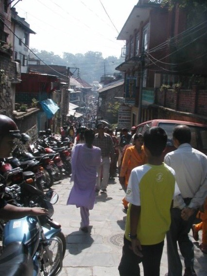 A typically busy, narrow street in the centre of Kathmandu.