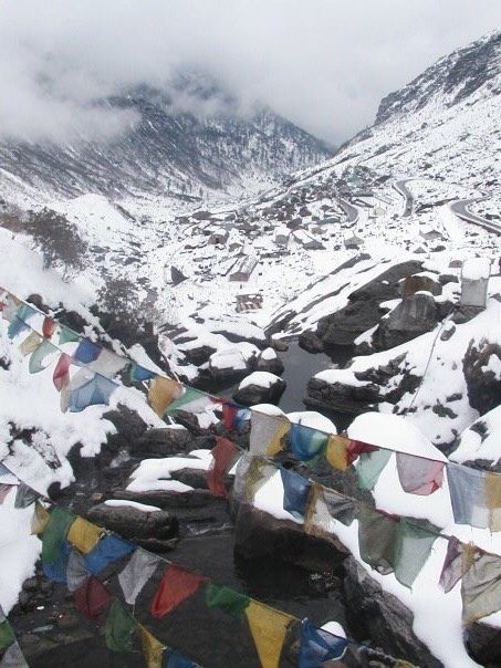 Buddhist prayer flags high up in the Himalayas during a trek.