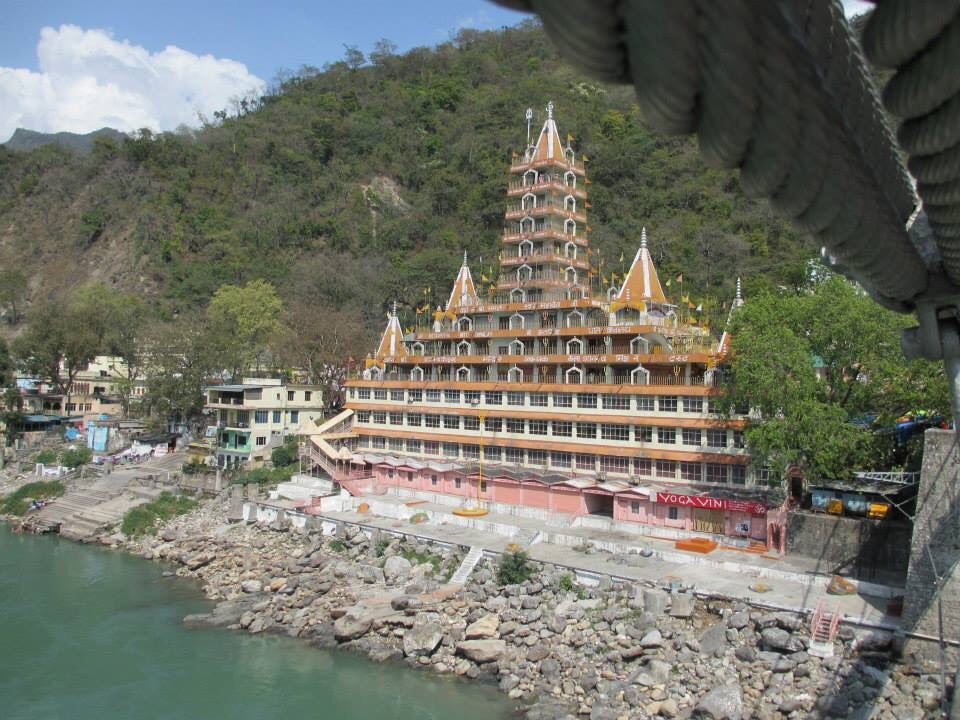 The Tera Manzil Temple (also known as the Kailash Niketan Temple) as seen from Lakshman Jhula bridge in Rishikesh.