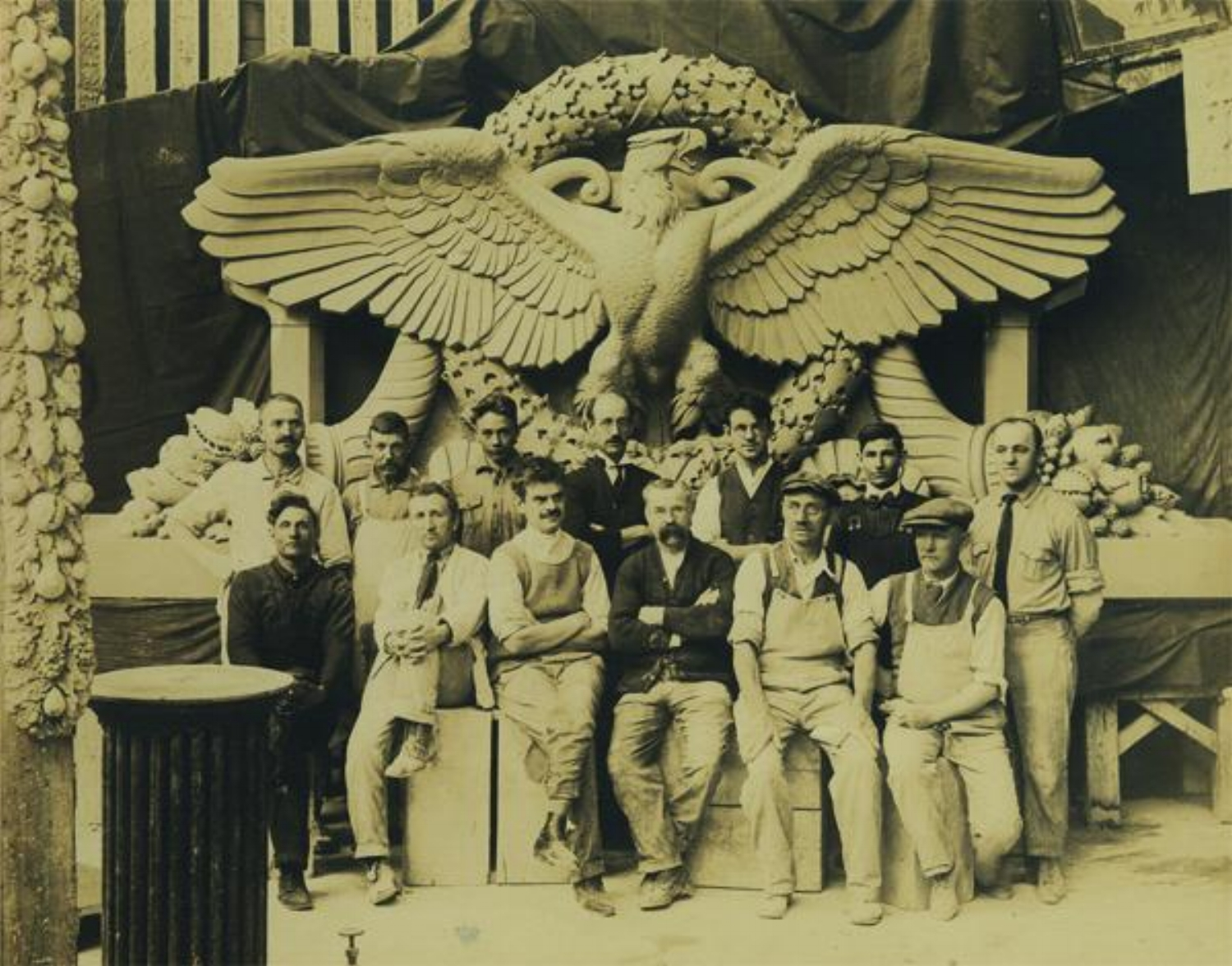 Edward de Csipkes, pictured above, first row, third from the left, was one of the leading artists and sculptors working at Atlanta Terra Cotta during the construction of the Woolworth Building. A native of Romania, de Csipkes trained at the Master Art School in Budapest and was an internationally recognized sculptor before immigrating to the United States in 1903. He moved to Tottenville, Staten Island in 1913 and began work as a modeler for Atlantic Terra Cotta. [Information and photo sourced from skyscraper.org]