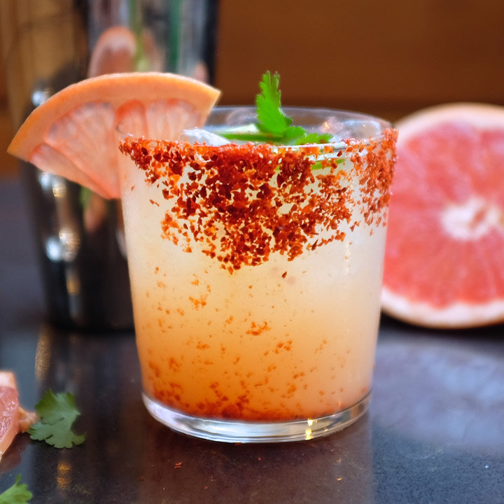 THE PALOMA - INGREDIENTS:2 oz Tequila Patrón Silver3 oz Fresh grapefruit juice, plus a grapefruit wedge1/2 oz Fresh lime juice1/2 oz Simple syrup 2 oz Club soda1 Tsp of Ancho Chile Powder1 Tsp of Kosher Salt