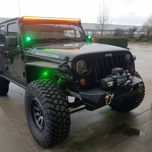 Just finished sprucing up this sweet JKU. #foxshocks #rigidindustries light bar and cubes #visionx headlights #racelinewheels #maxxistires
