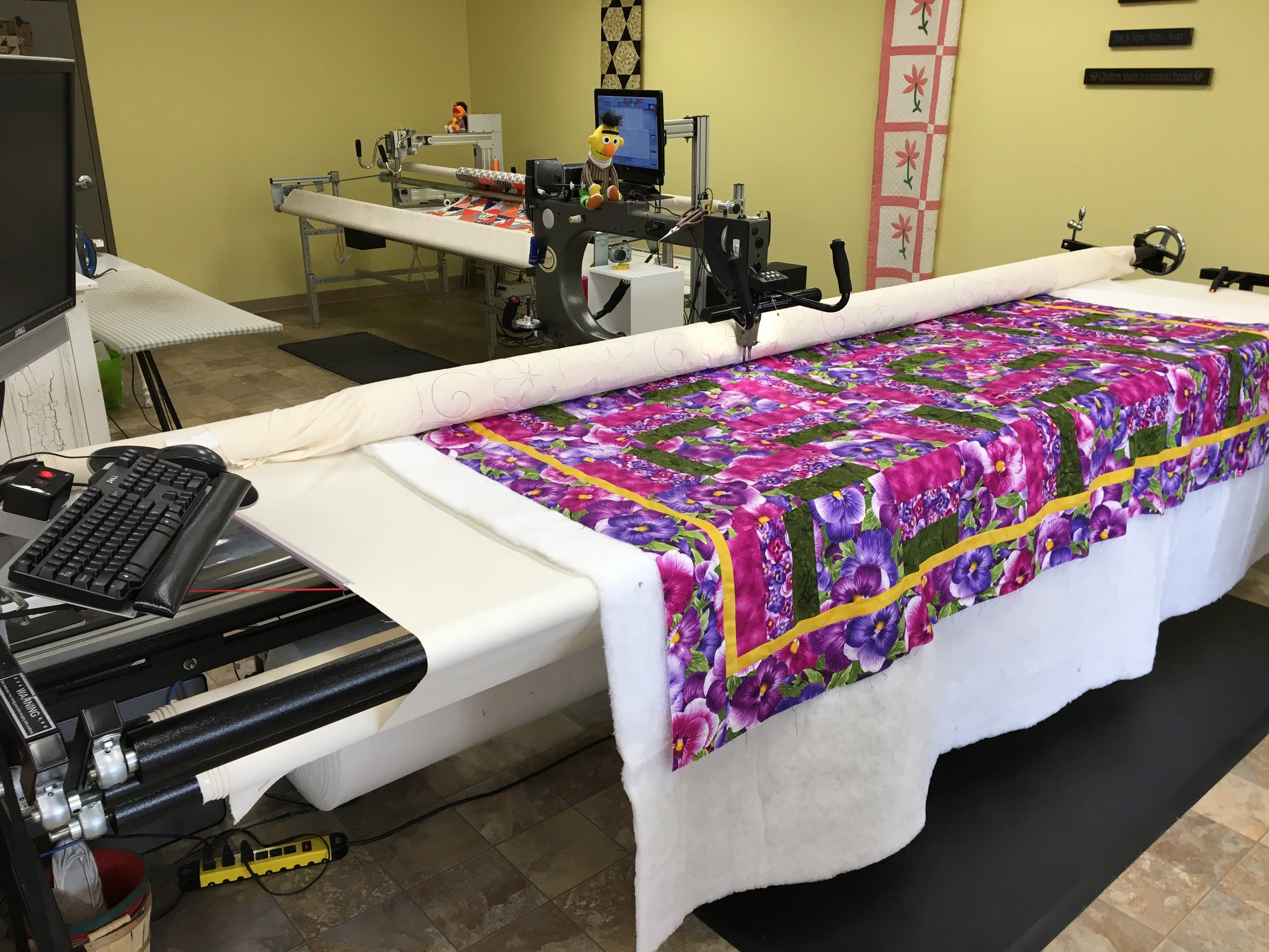 Quilt Services - Your choice of pattern quilted throughout the entire piece (called an edge-2-edge) $0.01/ sq. inEstimated six week turn-aroundCustom Quilting - quoted per projectTiered Custom Quilting: $0.03 - $0.06/ sq. in4 borders, center edge to edge - $0.03/ sq. inQuilt binding -$0.005/ sq. inExpedite Fee - $15.00 (for less than 4 week turn-around limit one per person)Batting offered: 80/20, 100% Polyester and WoolExtra Wide Backing Also AvailableFrequent Quilter Reward Card - $30 offafter 10th visit