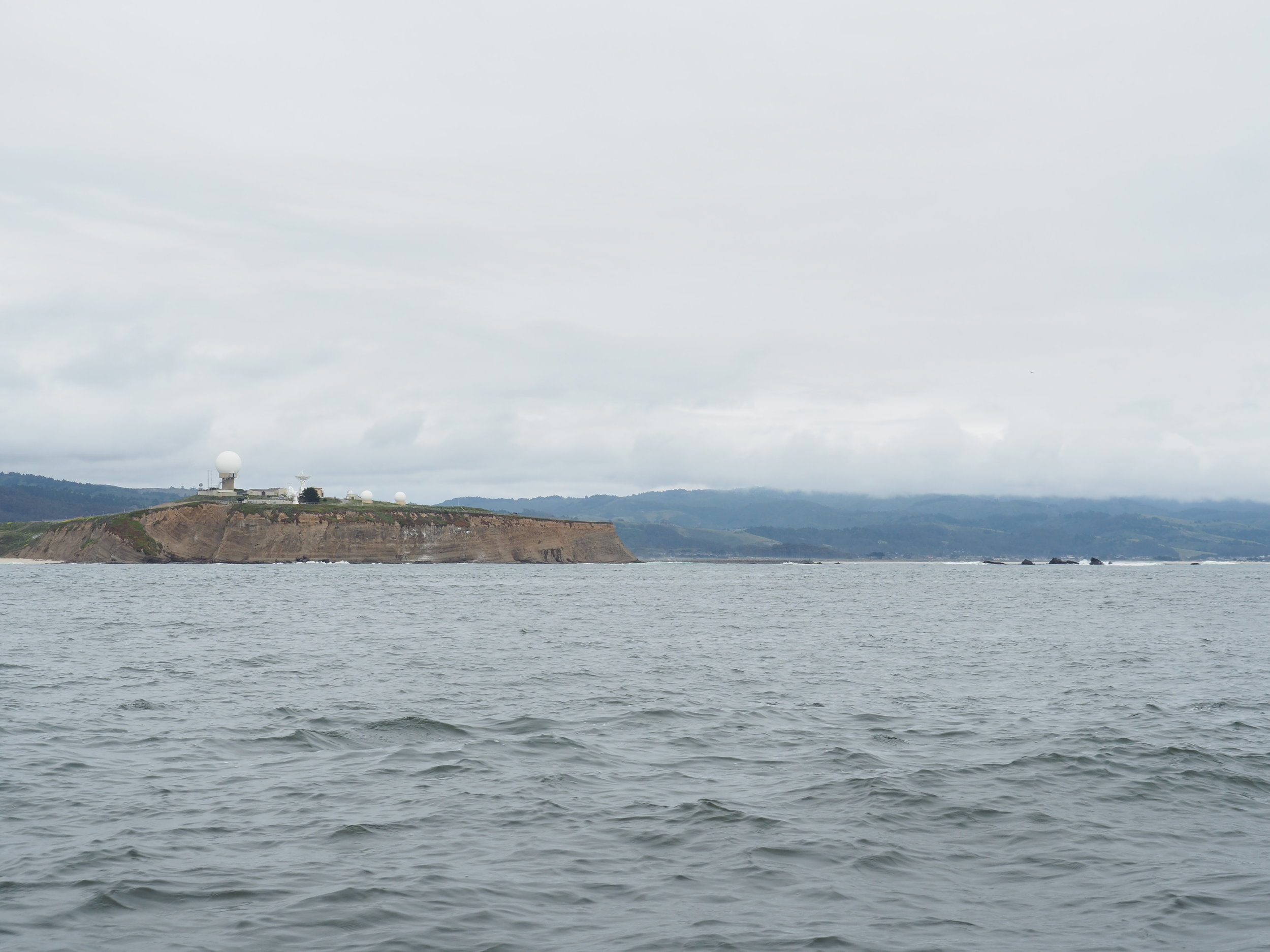 The radar domes of Pillar Point to the left and the rocks of Mavericks to the right. We gave those a wide berth and tucked into the outer harbor around the point.