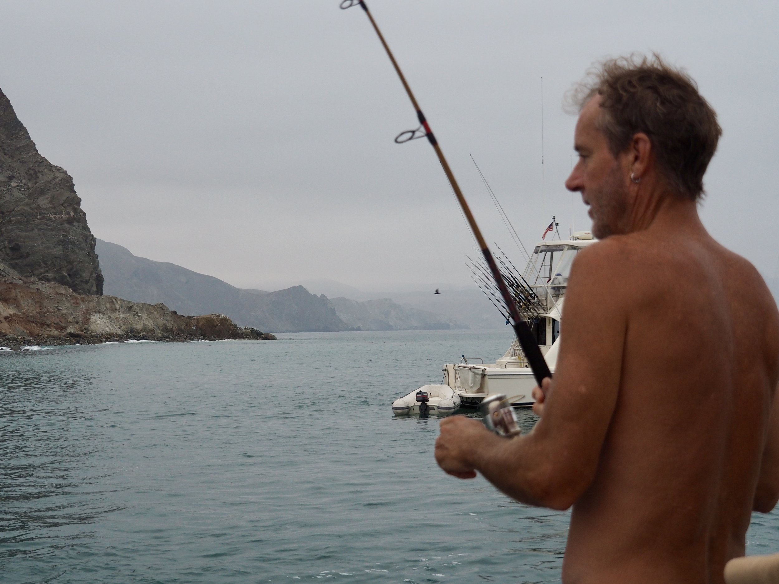 Woken by the call of the wild knocking on our hull, Colin wasted no time going after whatever was chasing the boiling mackerel around the boat