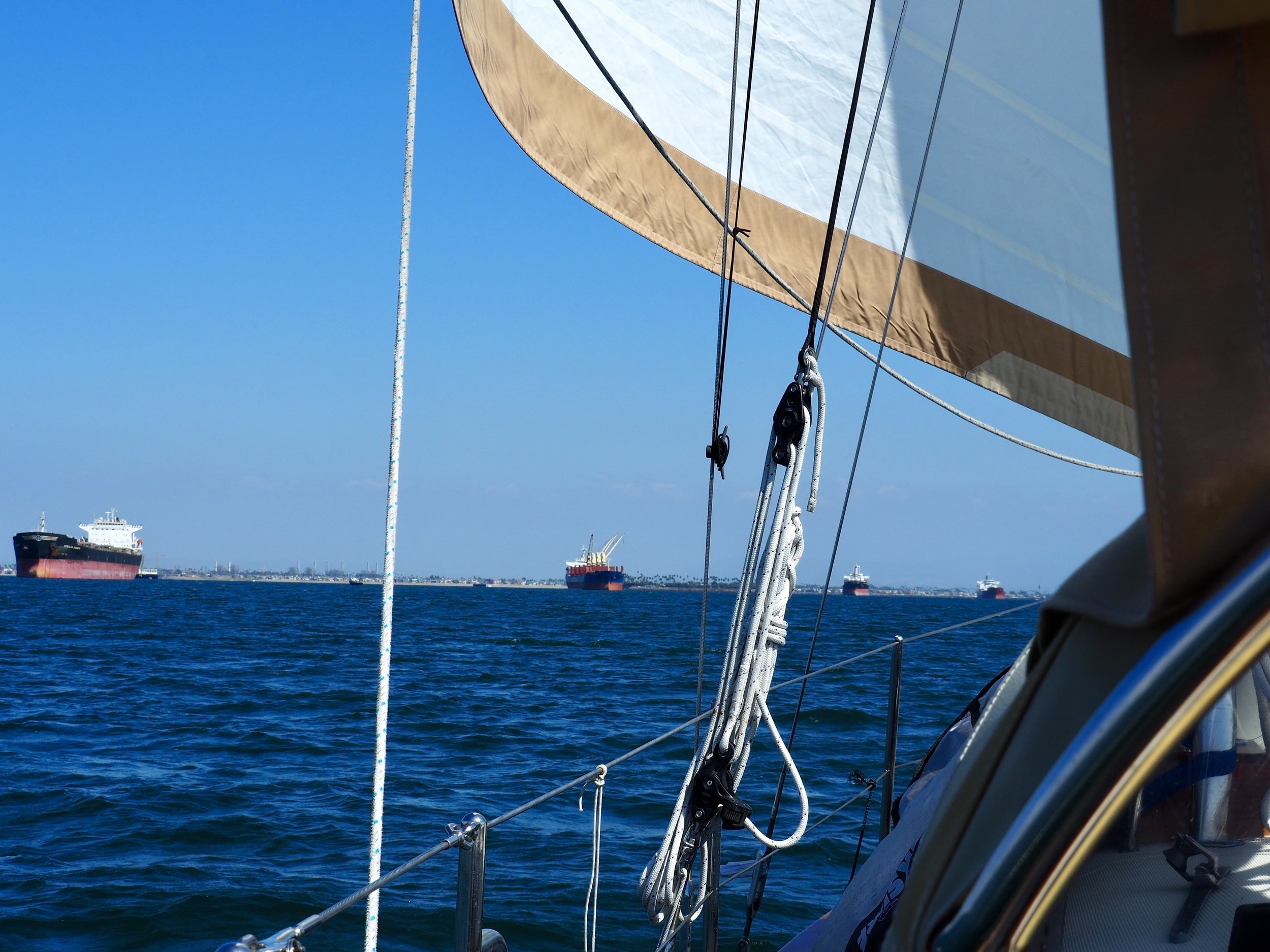 Dodging anchored freighters under sail on the way out of Long Beach Harbor.