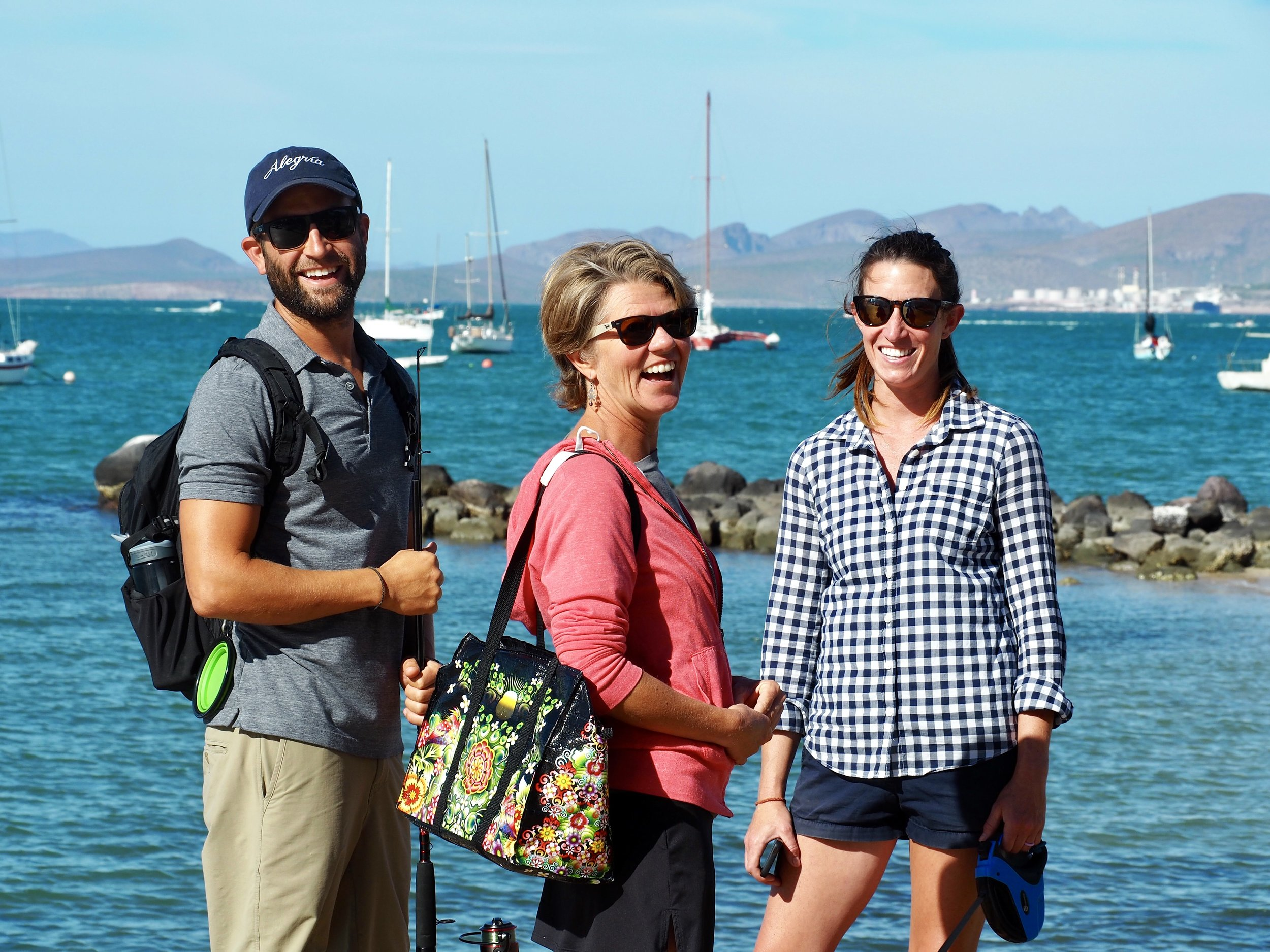 WIth Mike and Katie of  SV Allegría  along the La Paz Malecón. We spent the first several weeks anchored where the other sailboats are in the background.