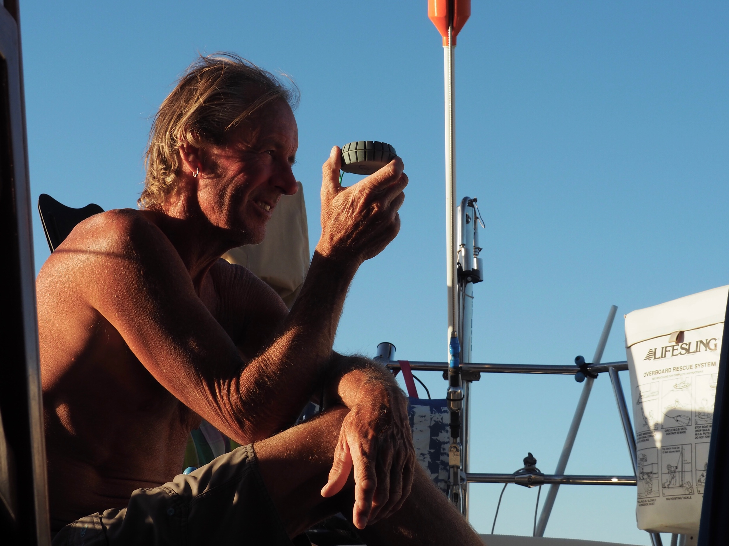 The good captain checks his bearings as the evening westerlies start whipping through the anchorage.