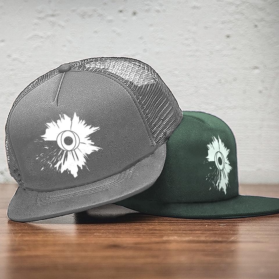 The logo mocked up onto trucker hats.