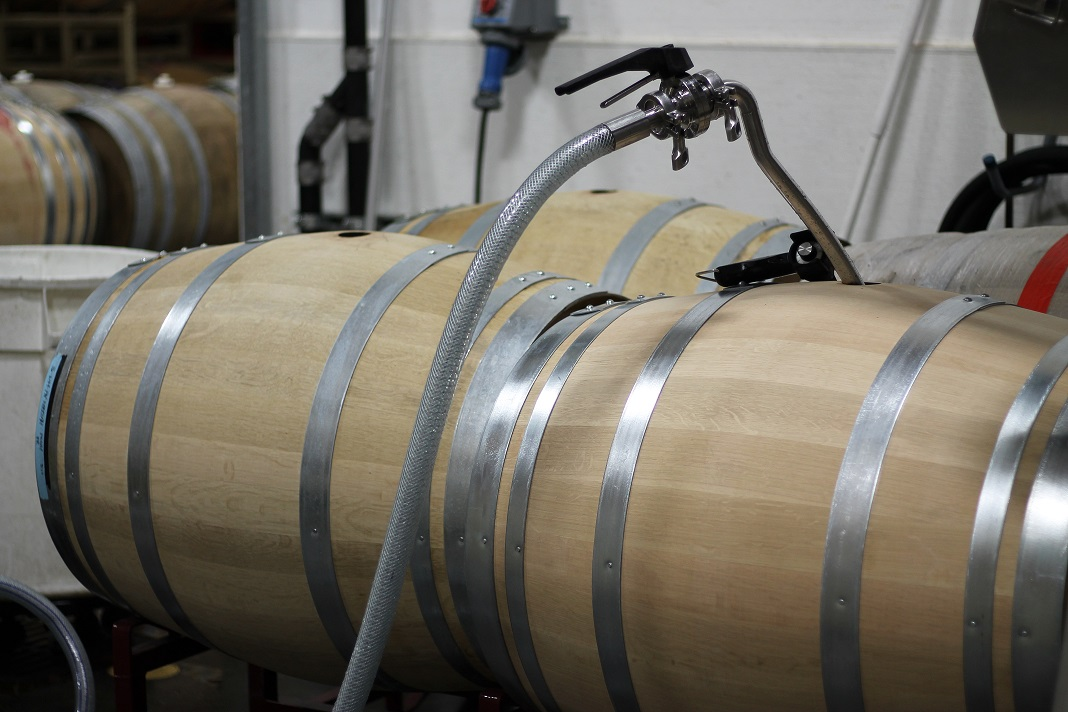 Waits-Mast pinot noir juice gets pumped into a new barrel. Photo: J. Waits/Waits-Mast