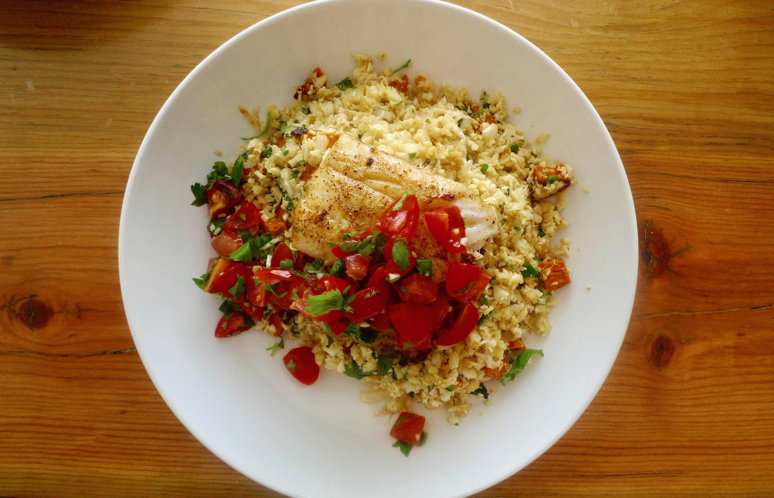 Fish taco bowl with cauliflower rice and pico de gallo.