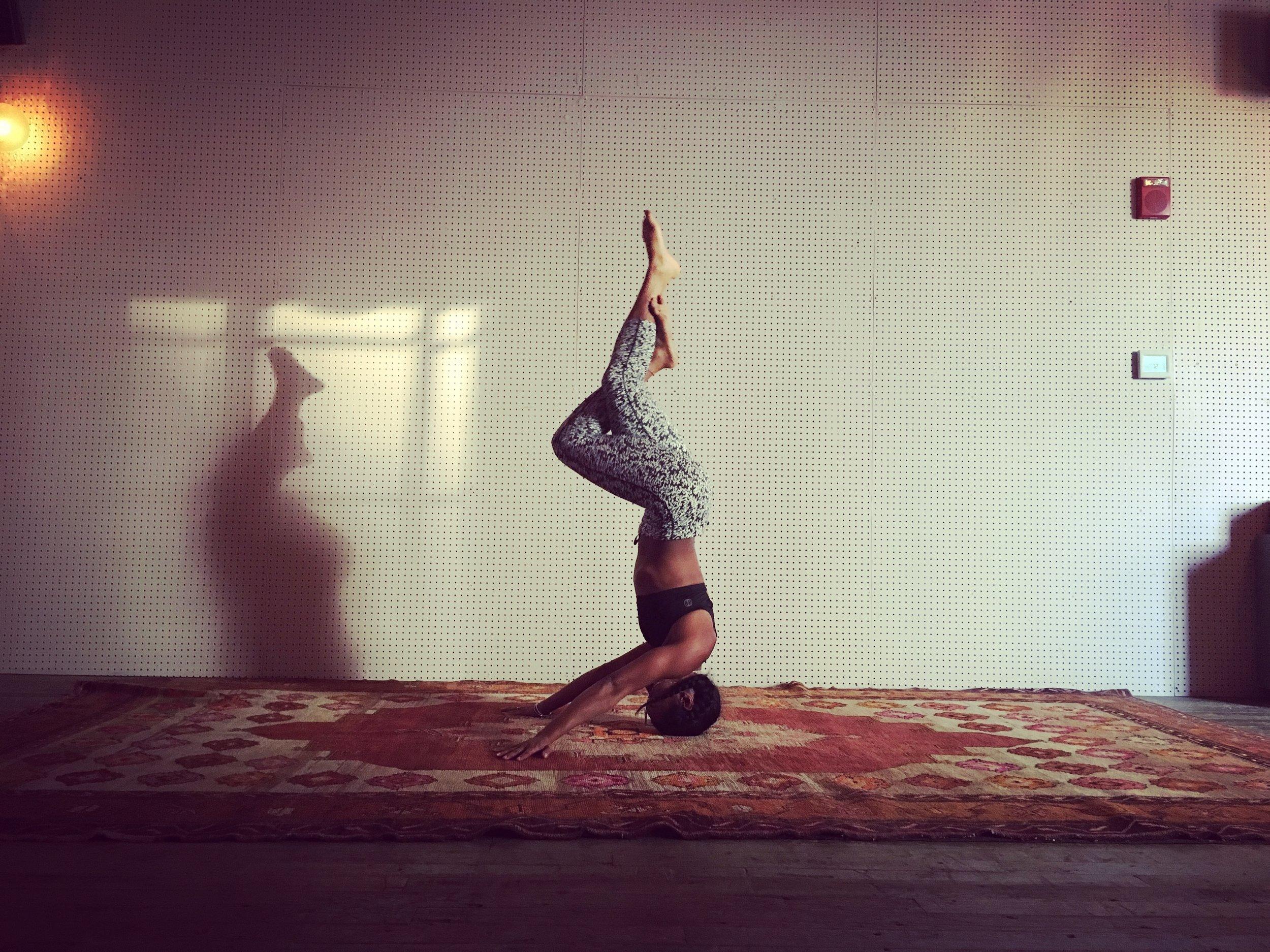 Asia Nichole practicing yoga.