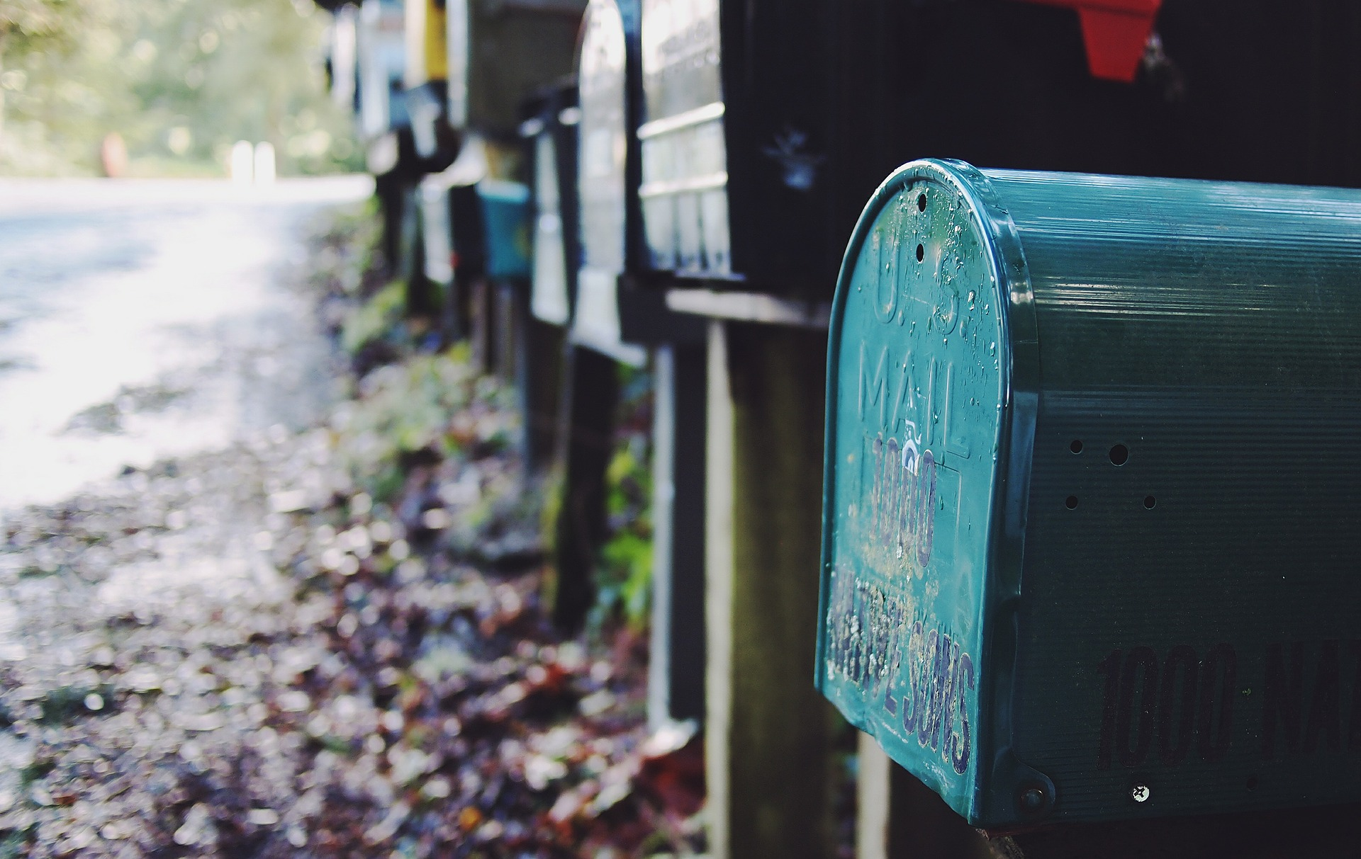 Send a birthday card. Pictured: Row of mailboxes.