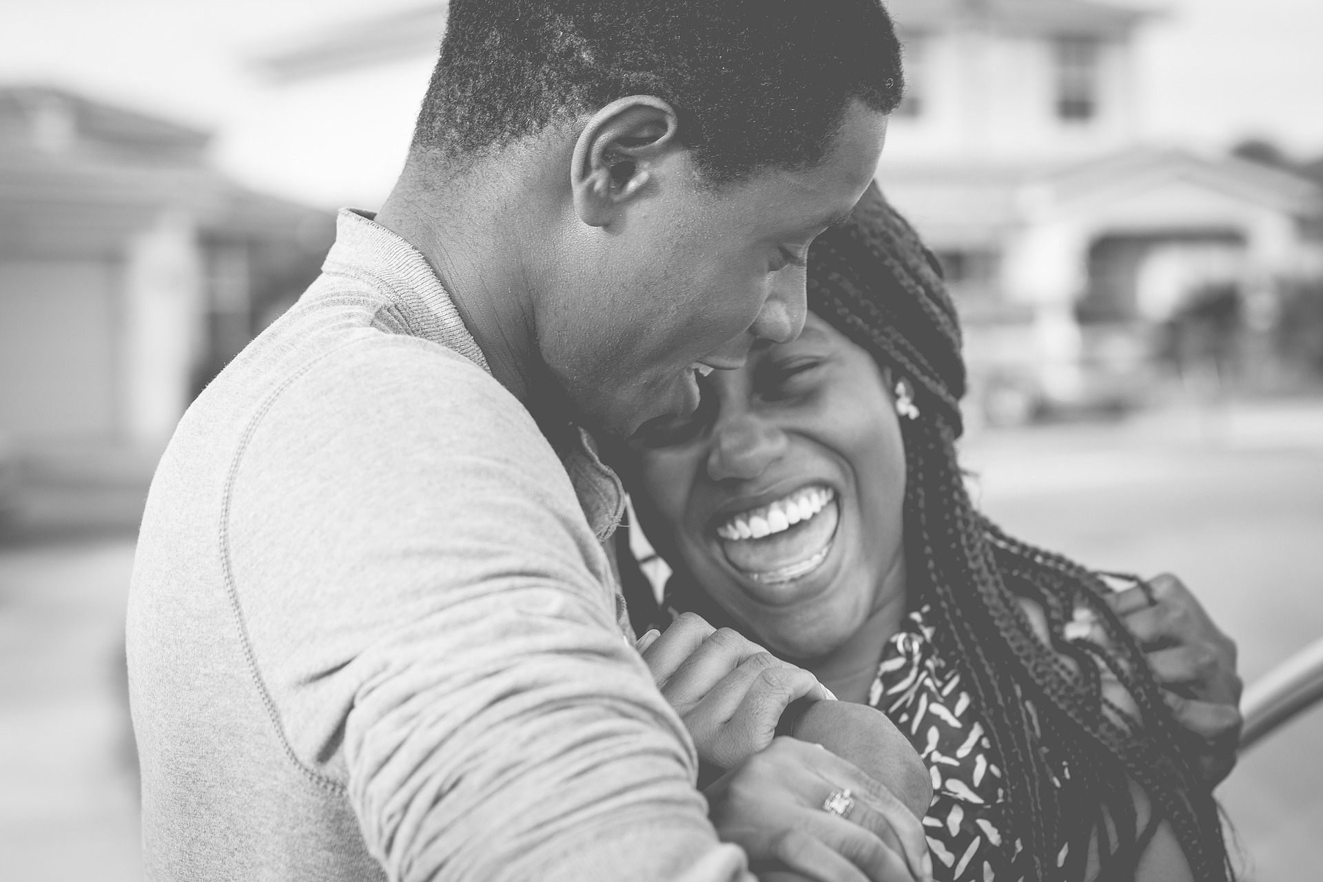 Have one thankful thought every day. Pictured: Couple hugging and laughing.