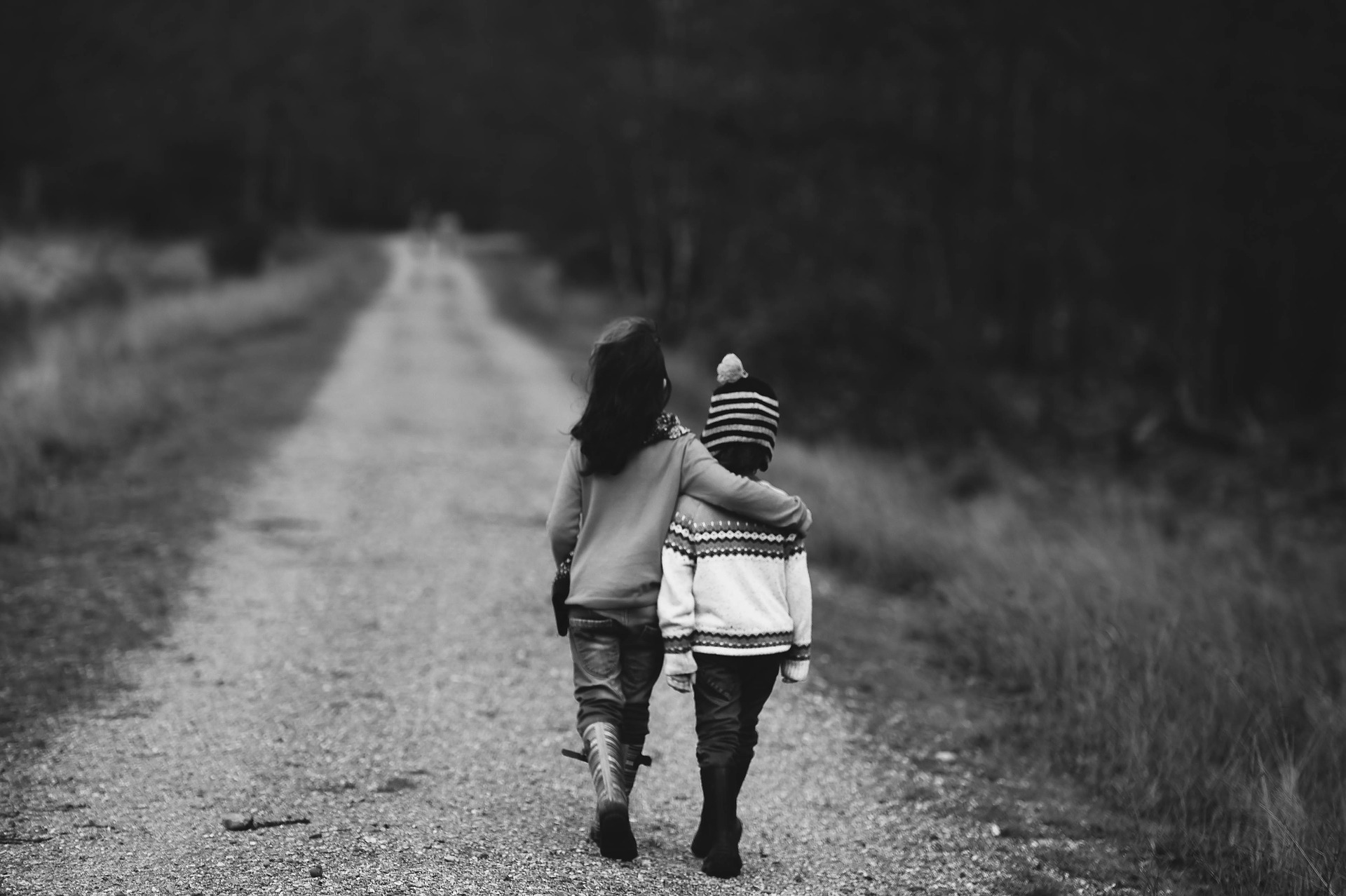 Make a small monthly recurring donation to your favorite nonprofit. Pictured: 2 children walking together.