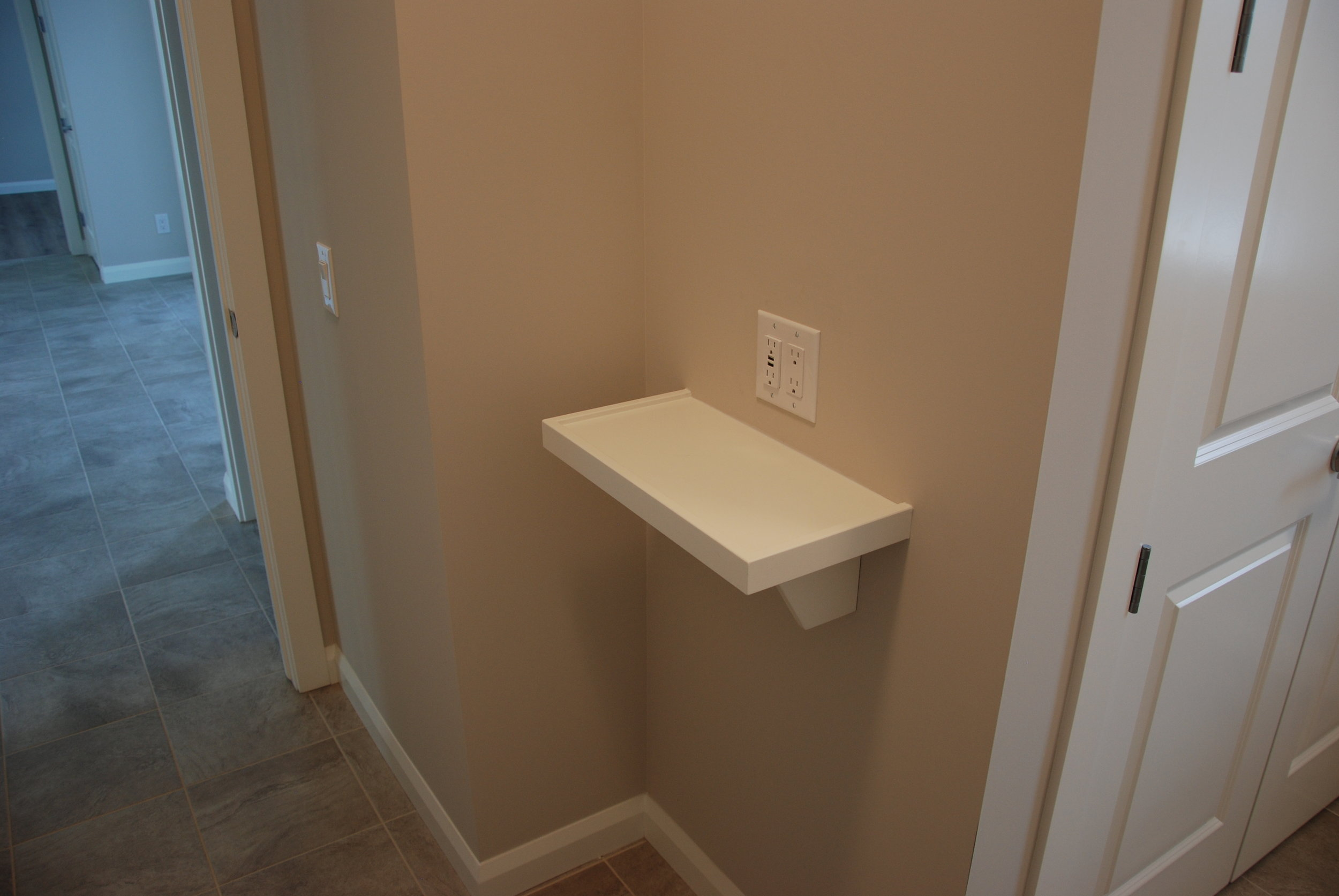 Thoughtful details like this USB charging station located in the entry way make modern day living convenient.