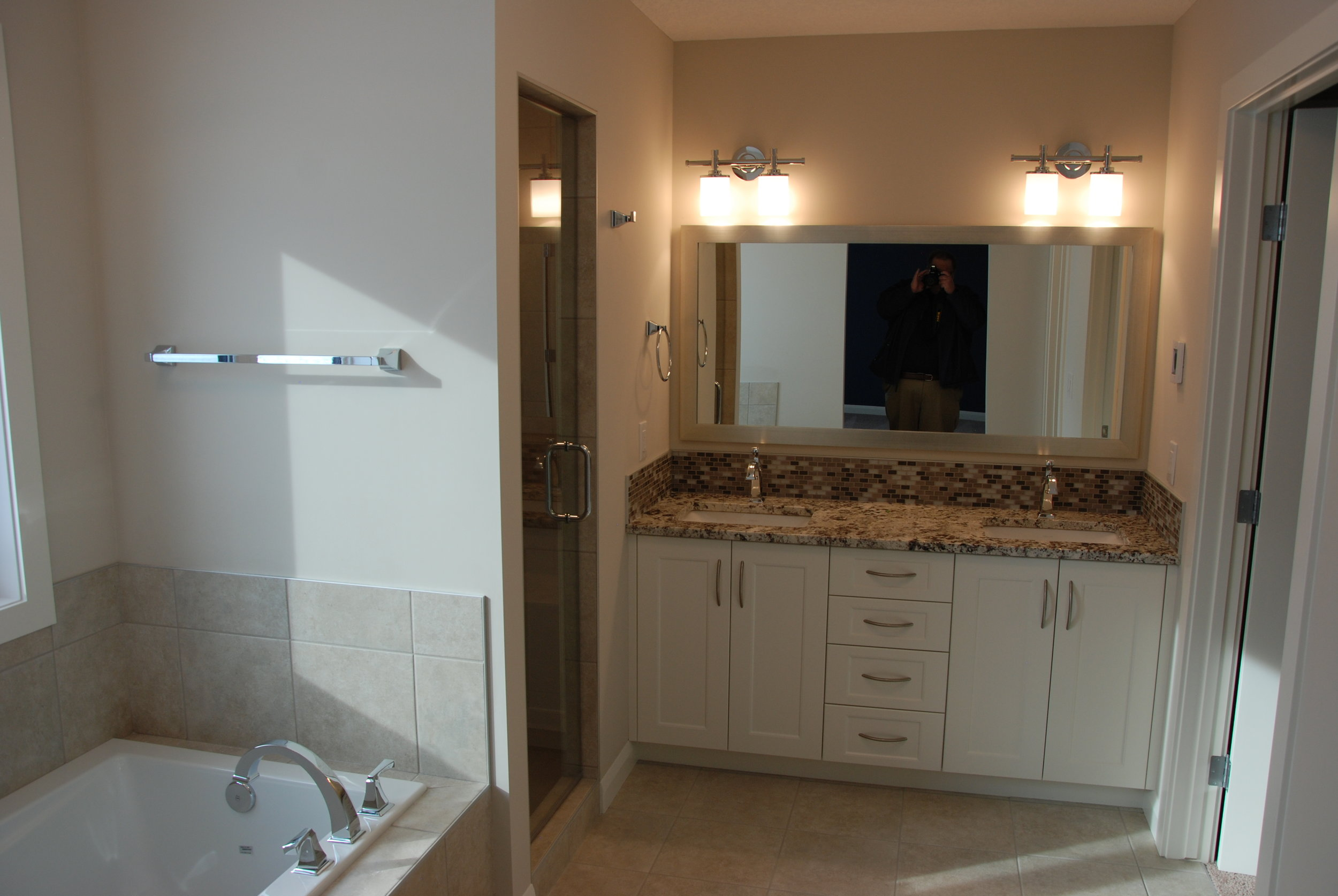 The master bath provides a blend of practicality and luxury.Heated Italian ceramic tile, a soaker tub and a steam shower provide an at-home spa feel, while his and her's sinks and a private toilet room make mornings easy.