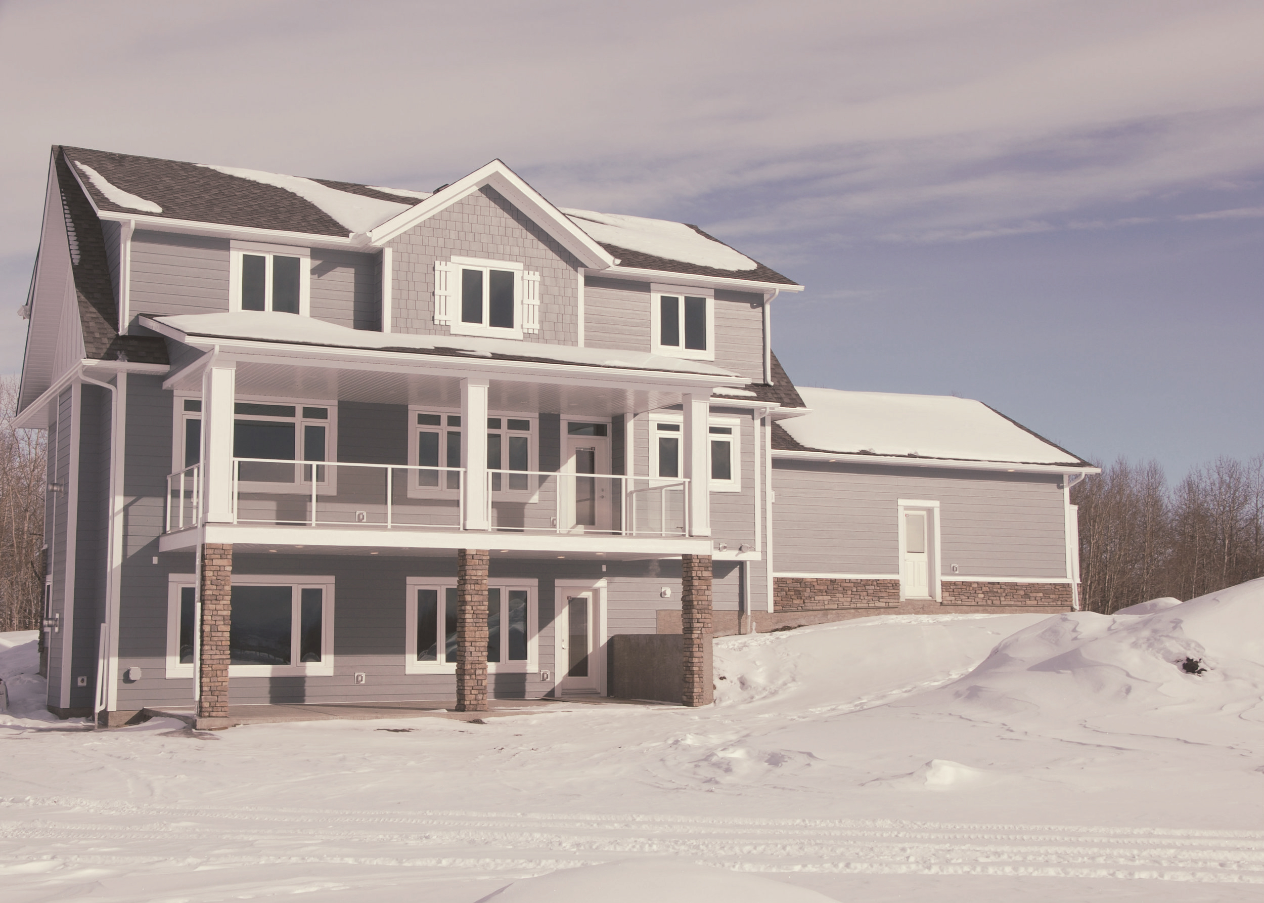 The back of the home faces westward towards the majestic rocky mountains. The covered patios make indoor-outdoor living accessible and comfortable.