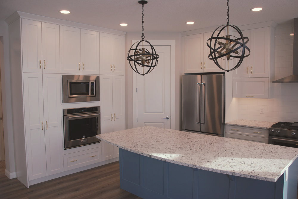 The open concept kitchen was designed with enough room for the bustle of a busy family and is just adjacent to the sunny breakfast nook.