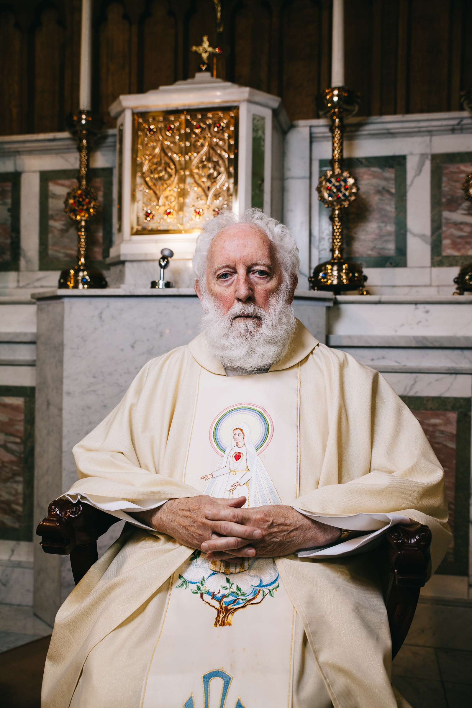 Quiet Reflection - Fr.Maher sits in his chair to reflect on the most incredible moment the earth will ever experience where God descends to us in the mystery of the Mass. His eyes were closed and he surprised me by opening them so I captured that moment.