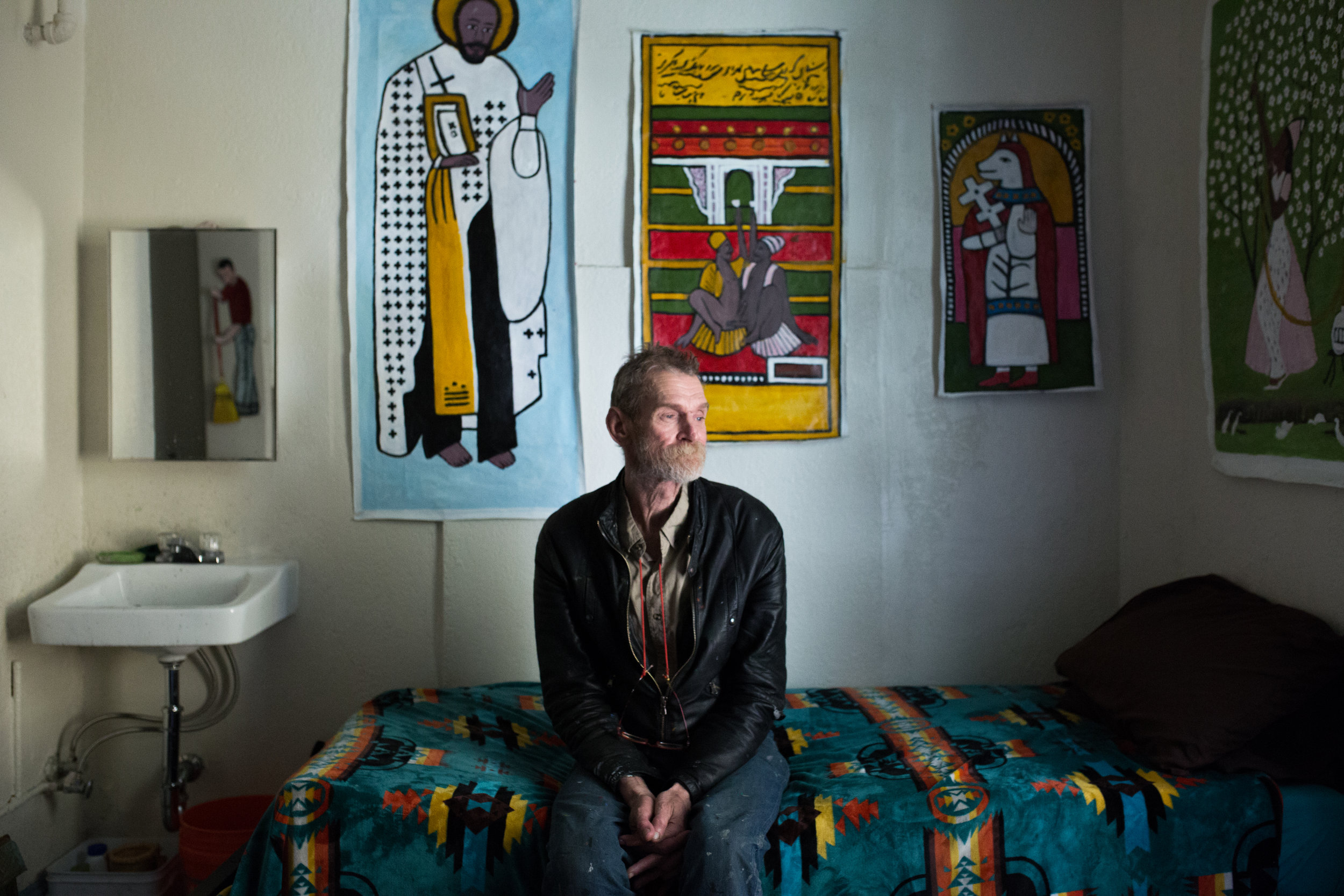 Jeff Marshall, resident of the Boyd Hotel sits in his single-residency occupancy room, or SRO, in the Tenderloin.