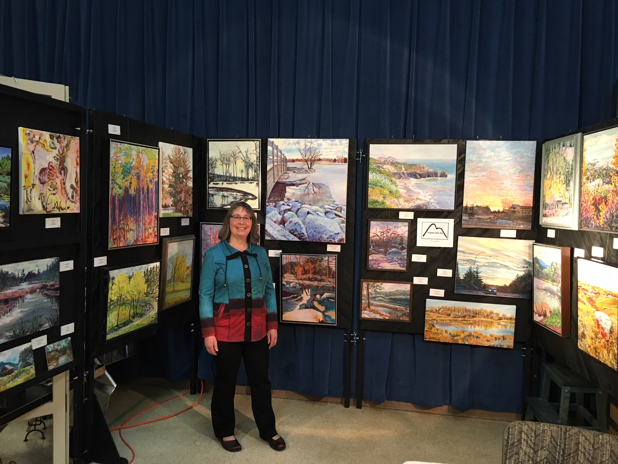 Standing by my paintings