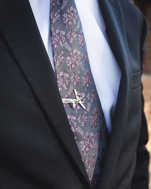 Highlighting little details, like an heirloom tie clip, make wedding photos so much more personal.