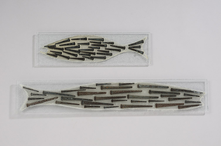"""Nail Fish, 2014, short: 4"""" x 14"""" x .5"""", long: 4"""" x 24"""" x .5"""", plate glass, resin, hand-forged nails"""
