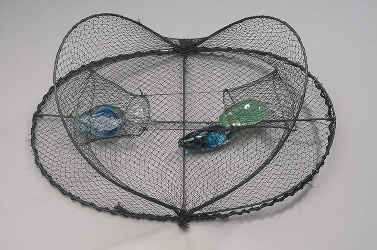 "Sally S. Fine —Trapped, 2014, 20"" x 30"" x 15"", blown glass, metal, mesh"