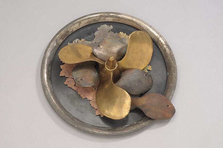 """Spin Offs, 2014, 8"""" x 14"""" x 14"""", bronze propeller, cast bronze fish, sheet metal"""