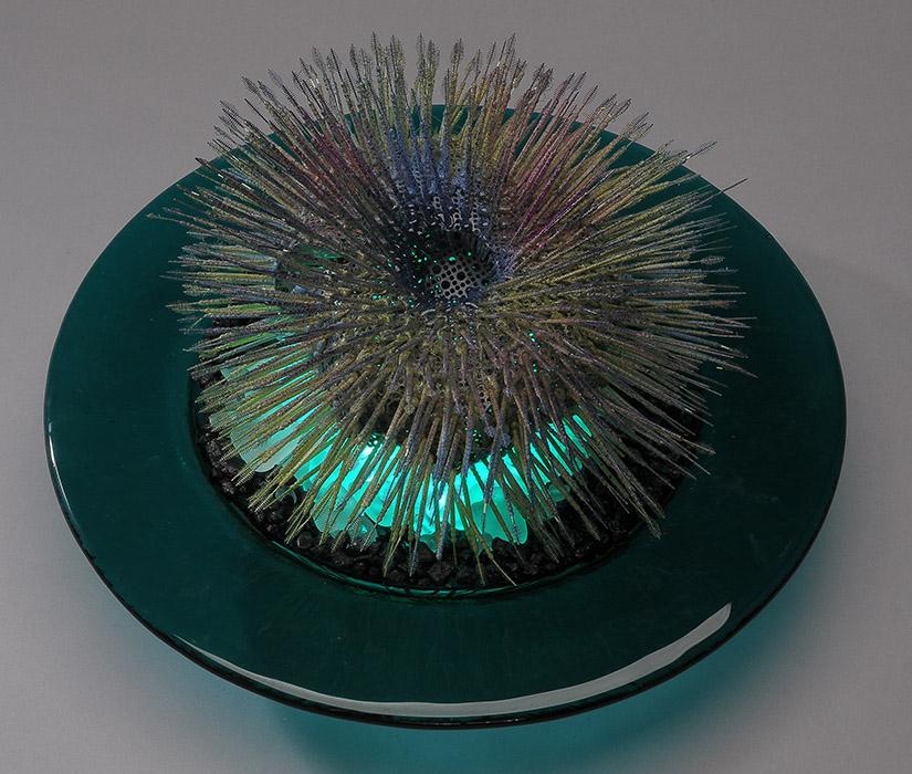 """Urchin on Ice, 5"""" x 12"""" x 12"""", plastic picks, metal, glass"""