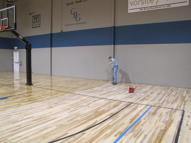 gym-floor-applying-finish-2.jpg