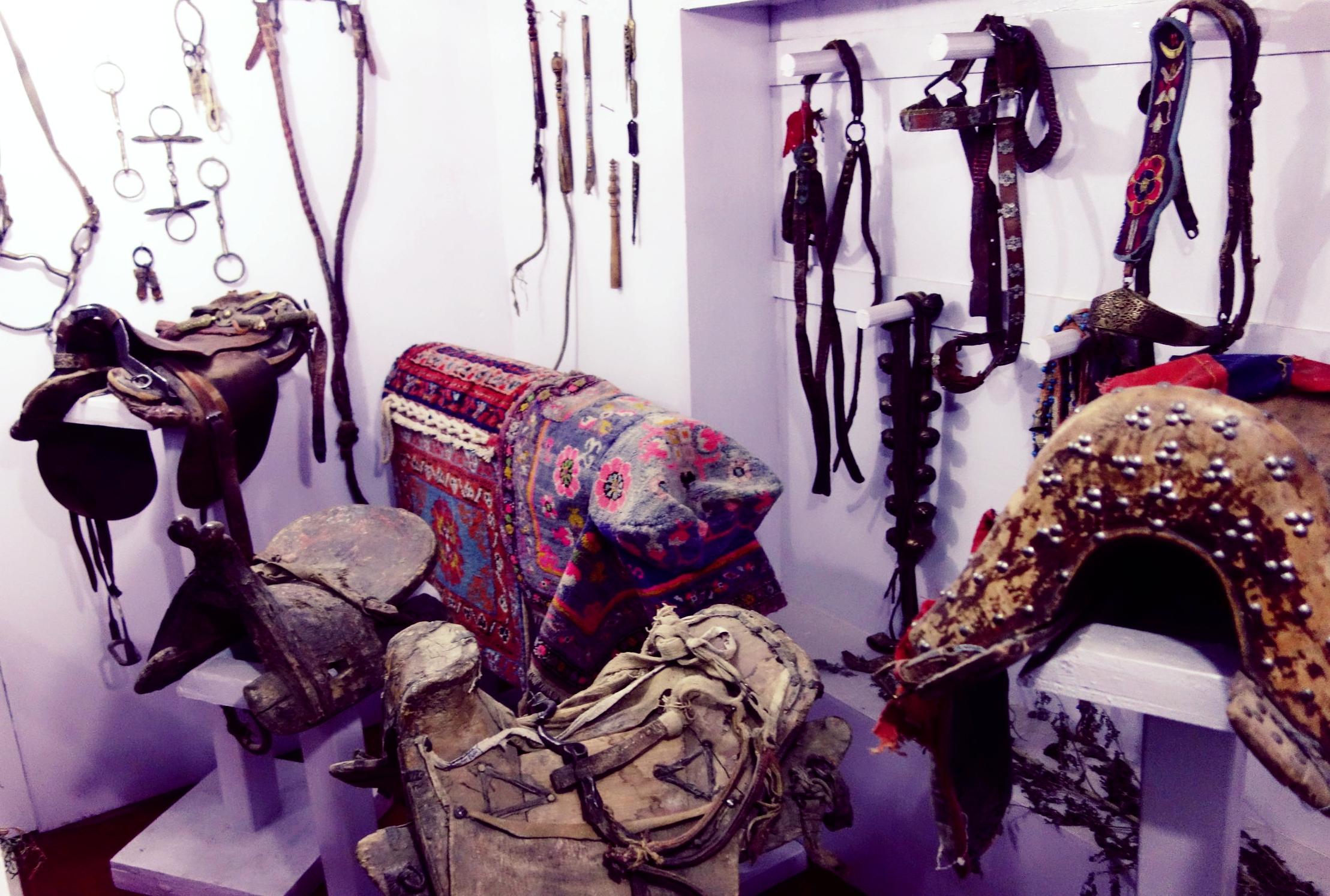 Horse Saddles from various Central Asian Countries at display at the Munshi Aziz Bhatt Museum, Kargil
