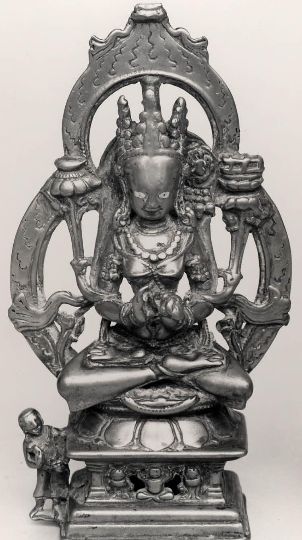 A bronze figure of Prajñāparamitā, holding a lotus and a book seated on a lion throne.