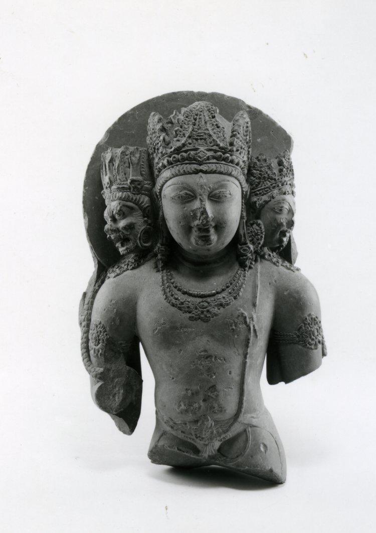 Standing image of Śiva Mahesamurti, feet missing. Made of green stone.  9th C