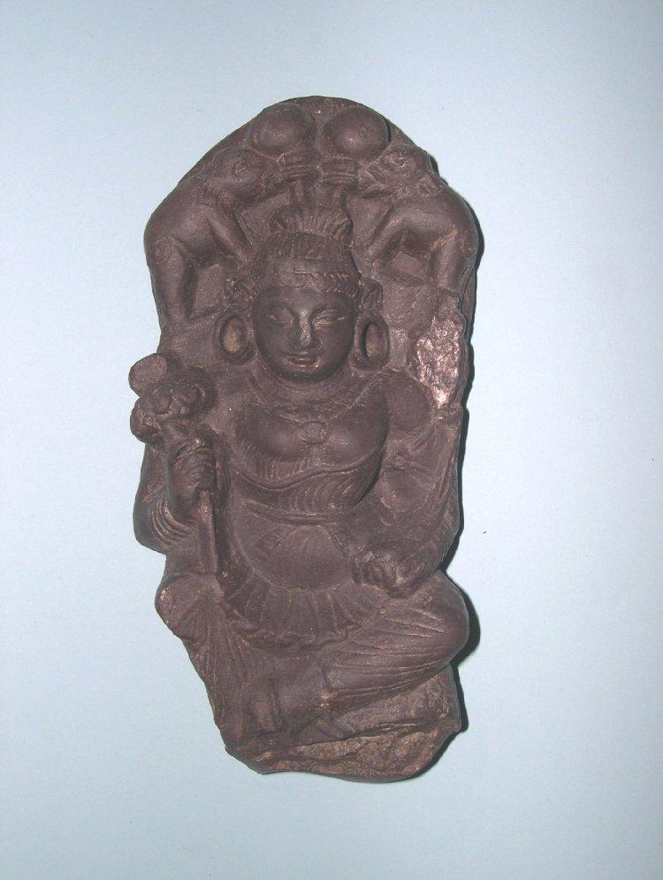 Figure. Steatite stone figure of Gaja-Lakṣmī, seated on a lion.  700 C