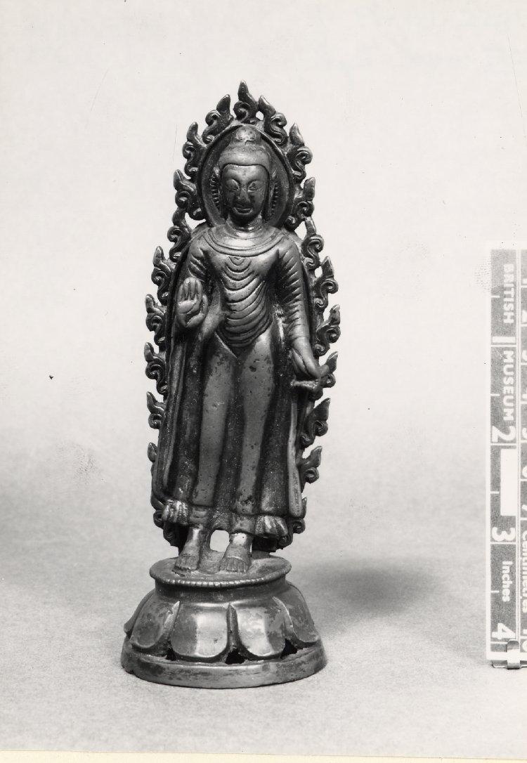 Figure (Buddha). Standing on lotus. Made of bronze. 10th C - 11th C