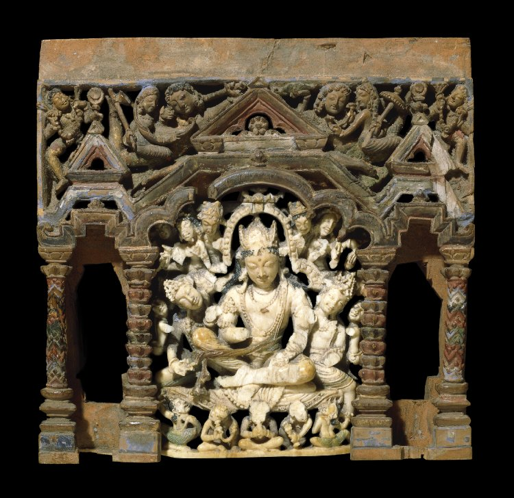 Part of a carved wooden Buddhist shrine (portable) with three niches: the central contains a figure of an ivory seated Bodhisattva flanked by many attendants. The left and right niches are are empty but probably contained standing figures of female attendants. 8th C  The empty niches on either side of the main figure held a pair of carved ivory female attendants now in the Cleveland Museum of Art.Zwalf 1985  This wooden panel, with one surviving seated Bodhisattva, probably belonged to a shrine imitating a Kashmiri temple which, even with a proportionately high superstructure, would have been readily portable. The Bodhisattva's crown, where a 'parent' Buddha might have been, is damaged and there is no other evidence to identify him. The flanking niches must also have contained acolytes. This form of Buddhist devotional object was a characteristic product of the Kashmir region.