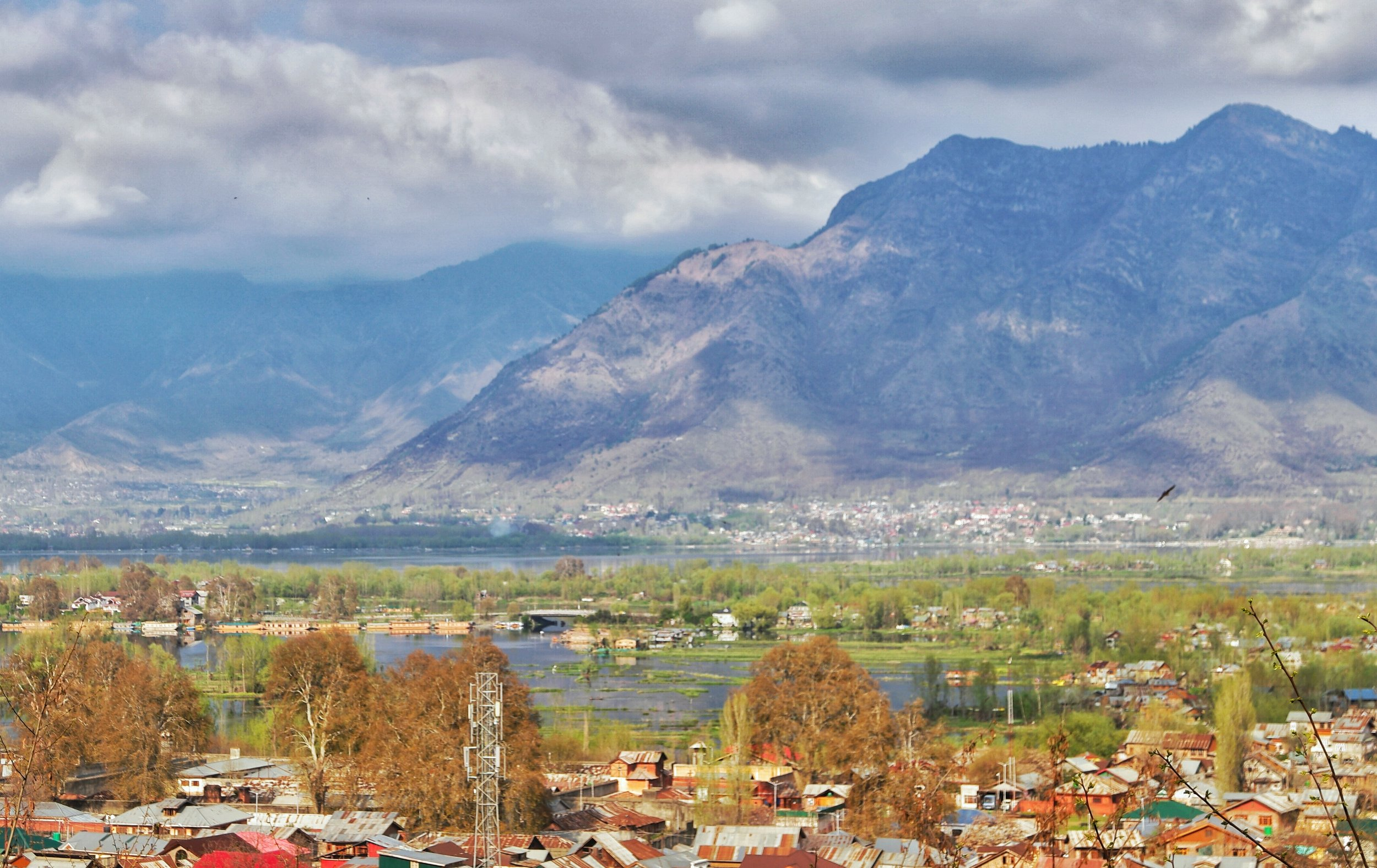 A view of the Nigeen Lake in the foreground and the Dal Lake in the background with the Zabarwan Mountains in the background.