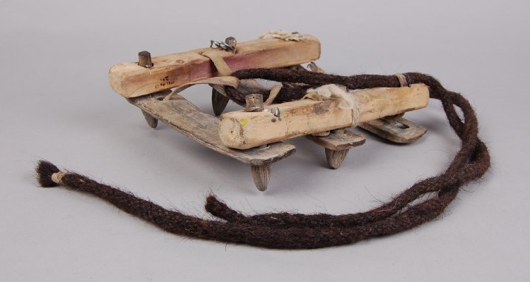A Crampon made of Wood and Hide.